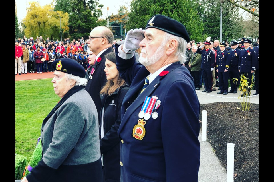 A veteran salutes during the moment of silence at the North Burnaby Remembrance Day ceremony. Chris Campbell photo