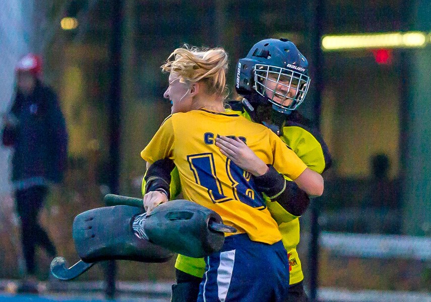 Collingwood defender Jamie Borthwick embraces goalkeeper Mo Kelly following the team's 2-0 win over Shawnigan Lake in the senior girls AA field hockey provincial final Friday in Victoria. It was Collingwood's third straight title. photo islandwavephotography.com
