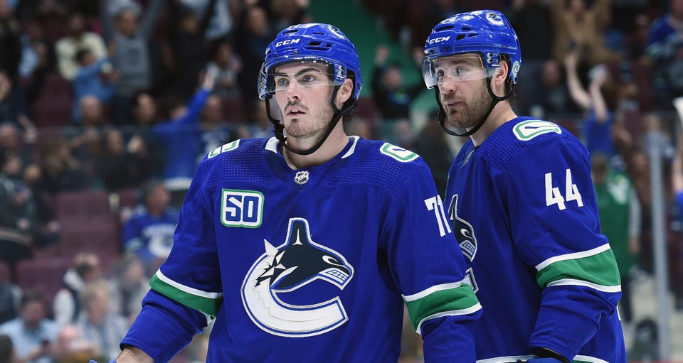 Zack MacEwen and Tyler Graovac line up for a preseason game with the Canucks.