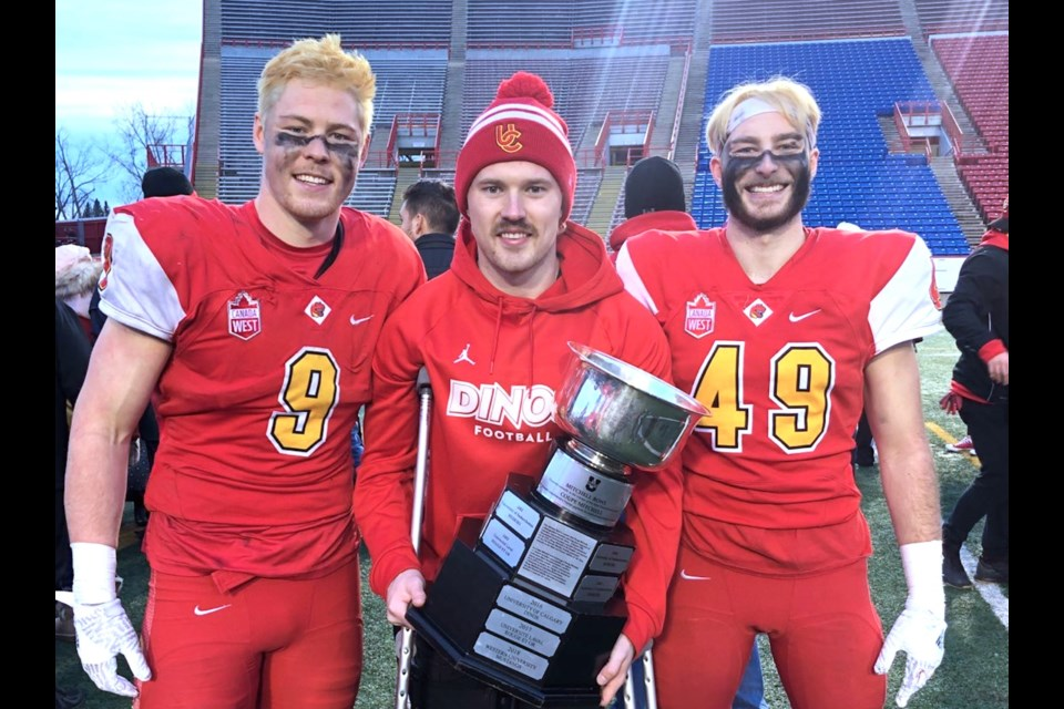 South Delta graduates (left to right) Grant McDonald, Jack McDonald and Jacob Kirk pose with the Mitchell Bowl after Calgary Dinos win over McMaster on Saturday at McMahon Stadium, sending them to the Vanier Cup next weekend in Quebec City.