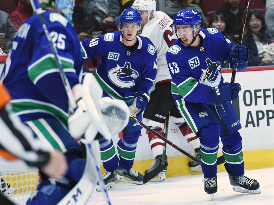 Elias Pettersson and Quinn Hughes chase down the puck in the Canucks 2019 preseason.