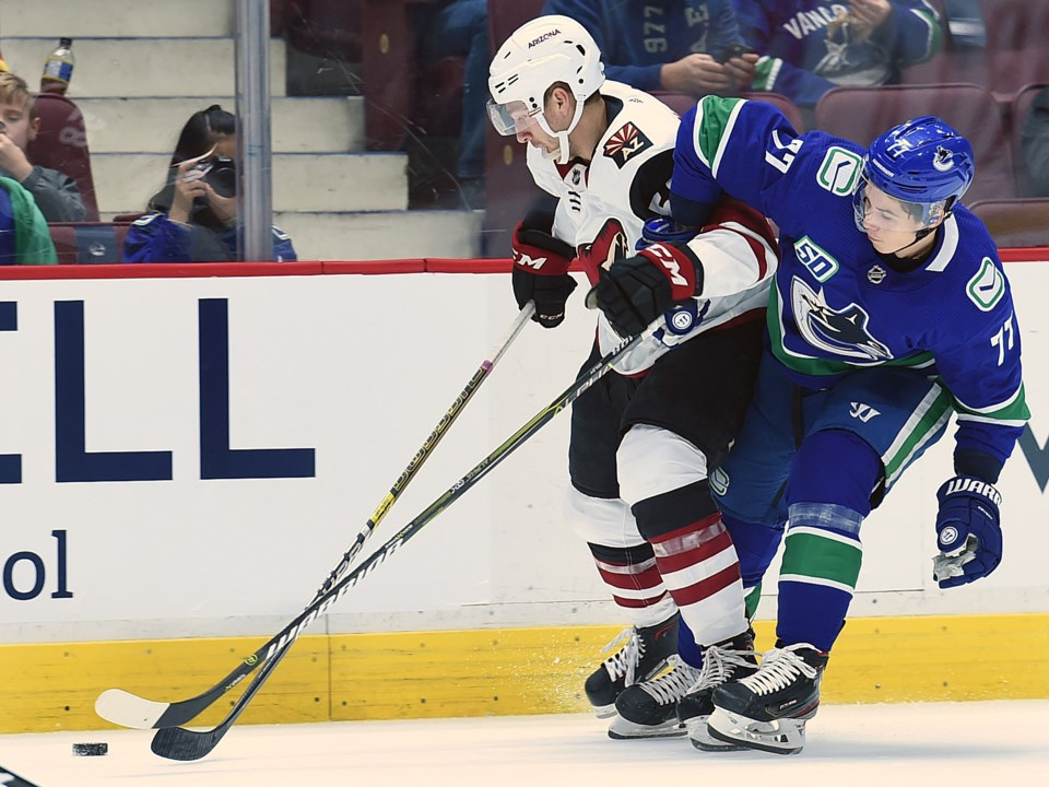 Nikolay Goldobin battles for a puck in the Canucks 2019 preseason.