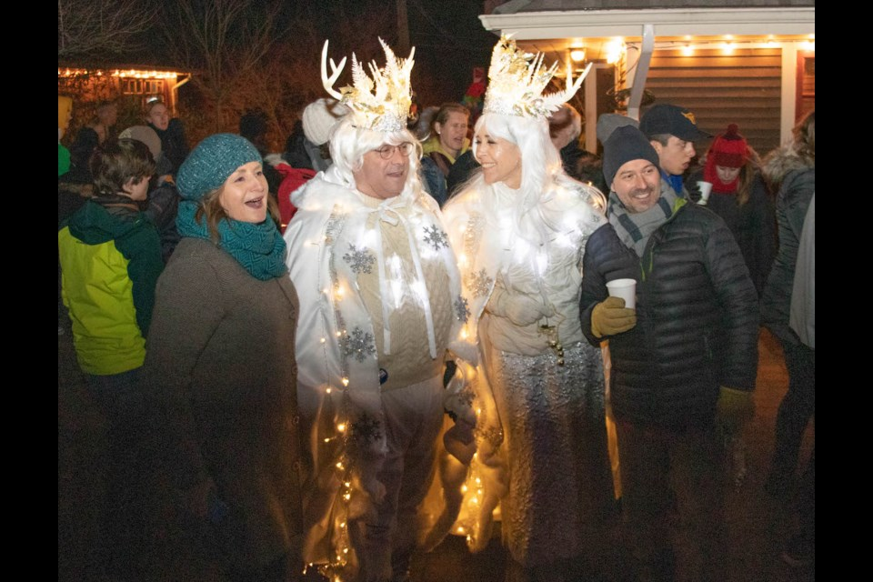 Julie Cree and Christophe Langlois pose with the snow king and queen as the festivities begin.