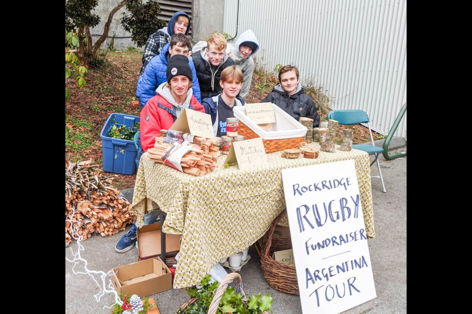 The Rockridge Rugby team is diligently fundraising to travel to Argentina, which includes having their own table at the CSA craft fair.