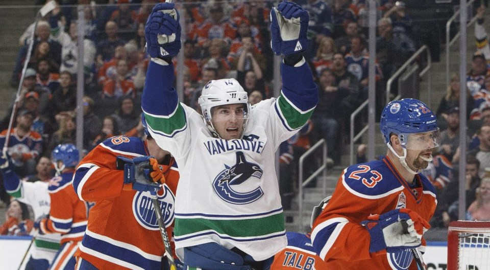 Alex Burrows celebrates a goal for the Vancouver Canucks against the Edmonton Oilers.