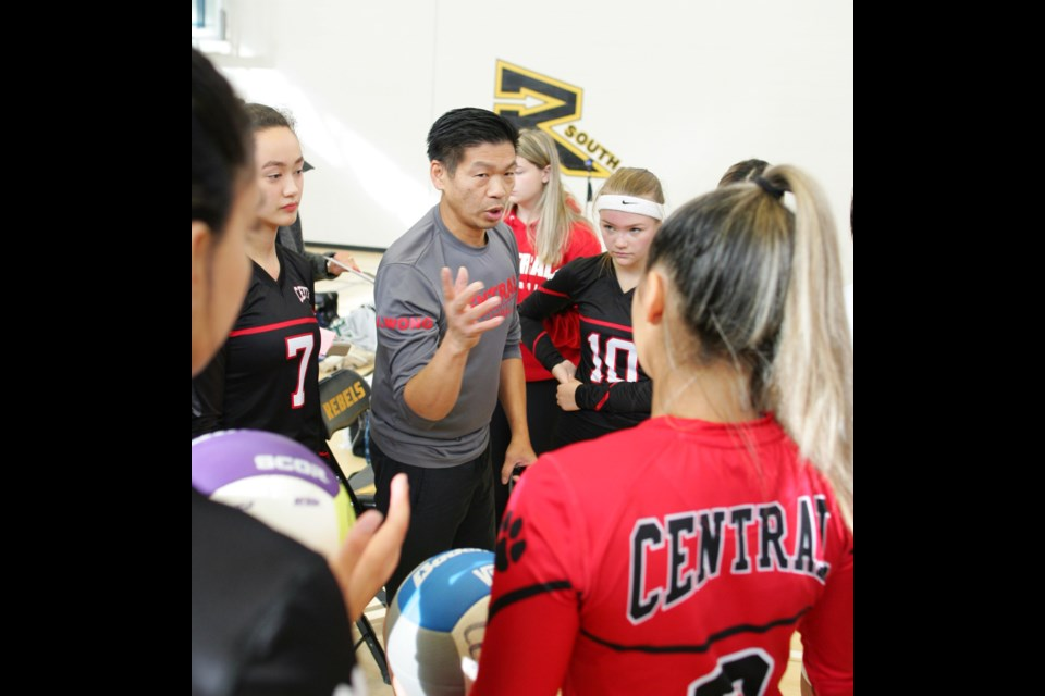 Burnaby Central Wildcats assistant coach John Wong talks strategy with the team during a tournament earlier in the season. The Wildcats captured twin banners this year en route to finishing 11th at the provincials last week.