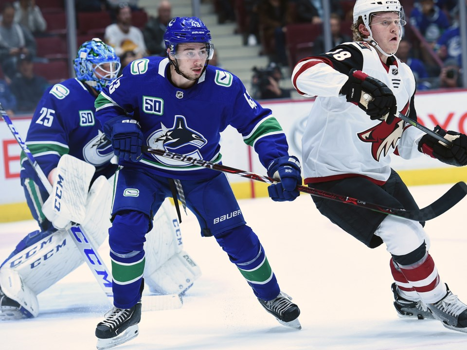 Quinn Hughes defends the front of the net during the Canucks 2019 preseason.