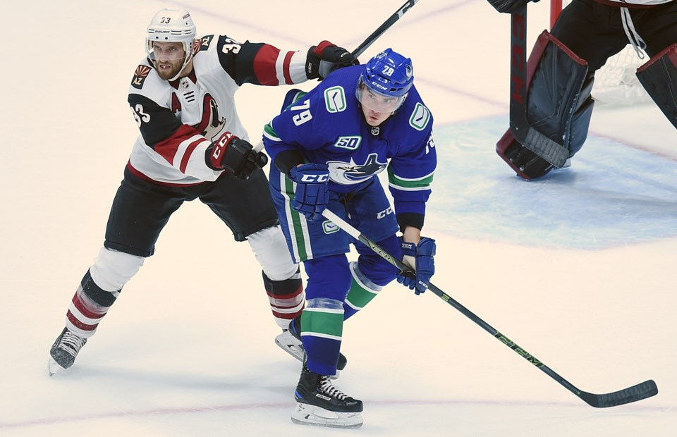Micheal Ferland battles for space in front of the net in the Canucks 2019 preseason.