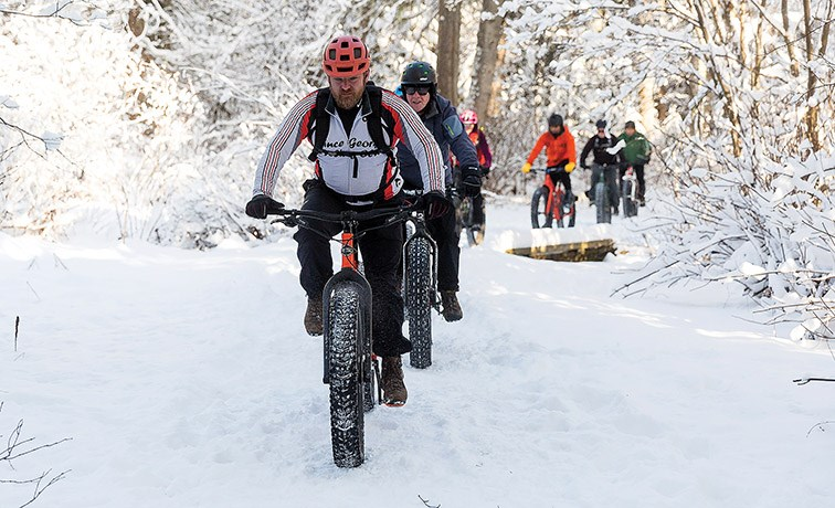 Citizen Photo by James Doyle. Cyclists make their way along the Greenway Trails on Saturday afternoon while participating in the Prince George Cycling Club's Fat Bike Season Opener.