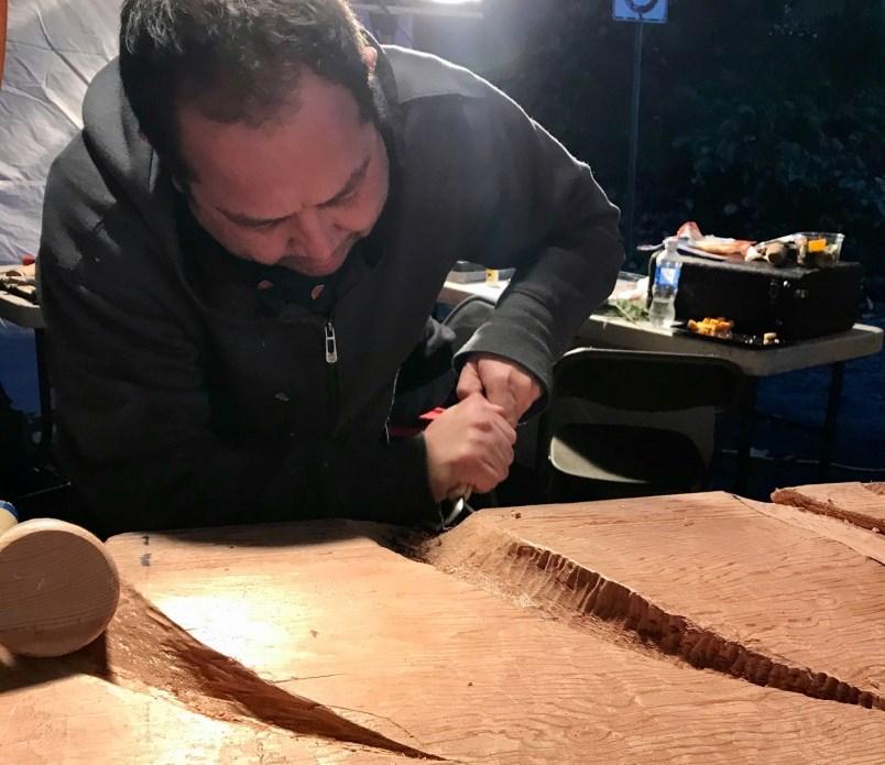 Kwantlen First Nation artist Brandon Gabriel carves Kwikwetlem First Nation symbols into a new house