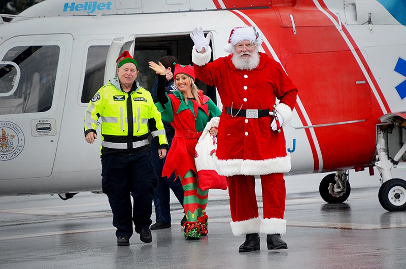Santa made his annual helicopter trip to Royal Columbian Hospital Tuesday, handing out stuffed bears and holiday cheer to sick kids and newborn babies.