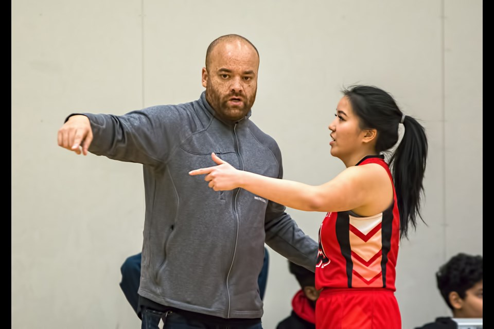 Burnaby Central senior girls basketball coach Chris Ducharme talks with a player during action last season. The long-time Wildcats coach feels this year's edition of the team is built for speed and a high tempo game.