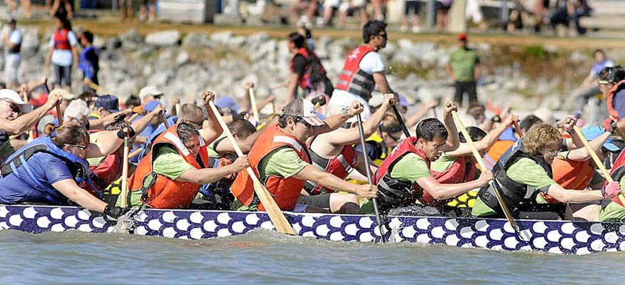 Dragons raged along Steveston Harbour in the 3rd Annual Steveston Dragon Boat Festival on Saturday. Almost 3,500 paddlers came to challenger each other and nearly twice as many spectators from Anchorage to New Orleans came out to watch the spectacle.