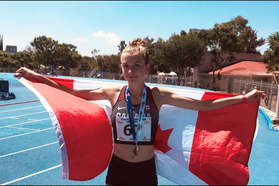 New West's Kate Stewart Barnett celebrates her gold medal victory for Canada at the u18 NACAC championships in Mexico.