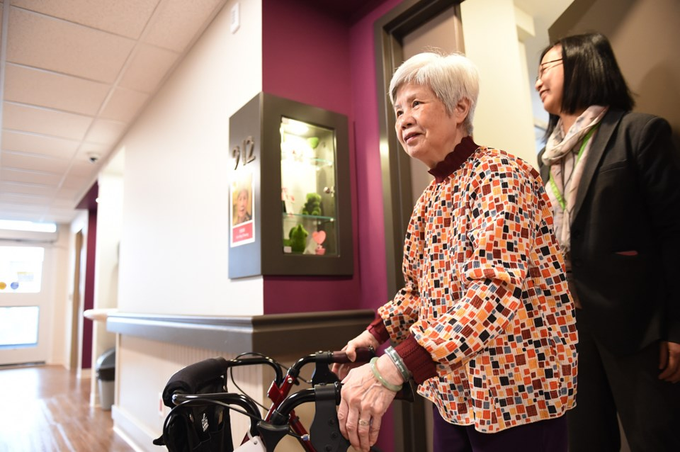 Doris Cheung, 75, leaving her new room at Villa Cathay Care Home in Strathcona. Behind her is care h