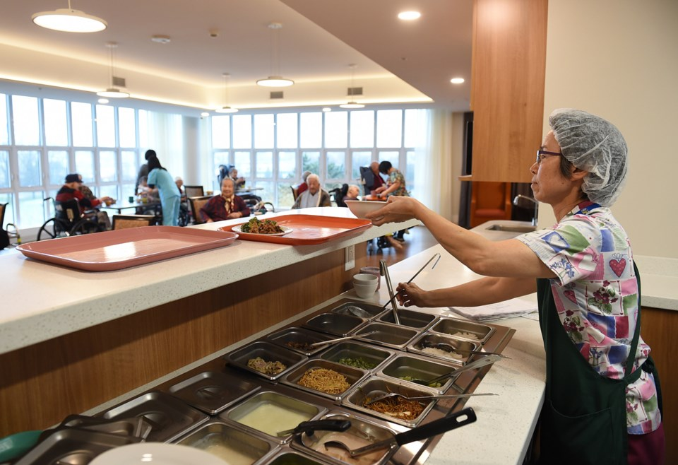 A staff member dishes out lunch. Each floor or