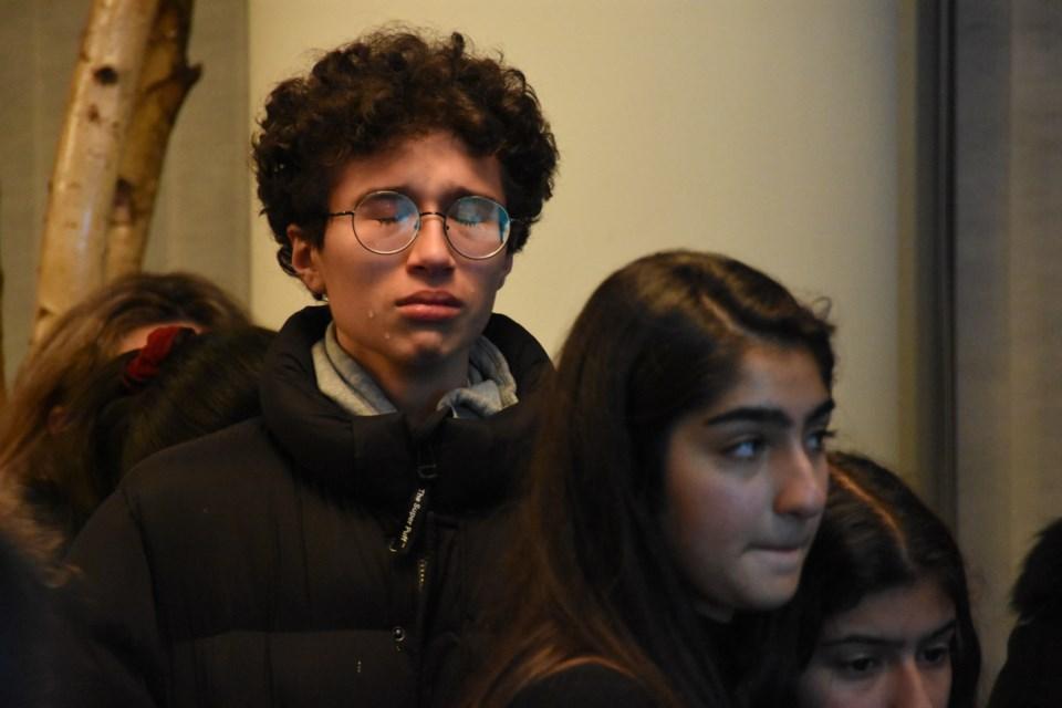A mourner as classmates eulogize 15-year-old Kamyar Ebnoddin-Hamidi, among the 176 people killed on