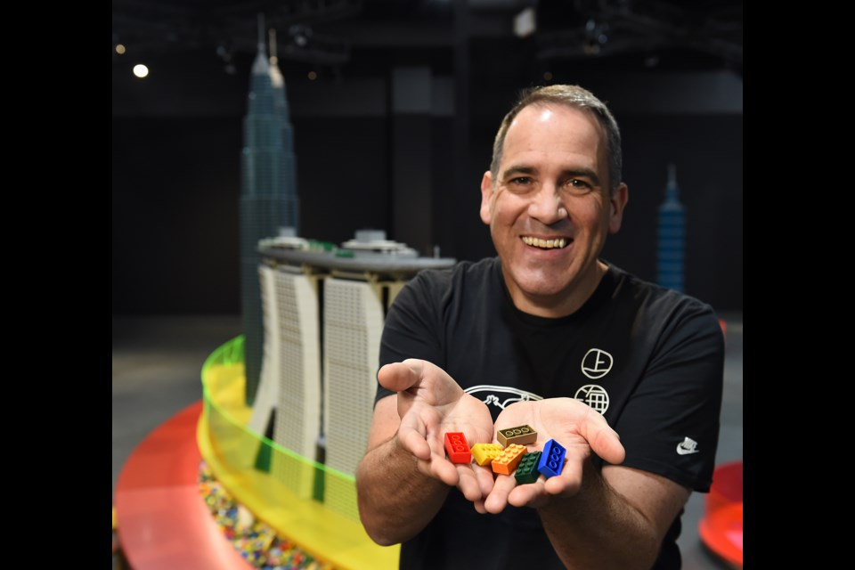 """One of 14 Certified LEGO Professionals in the world, Ryan """"The Brickman"""" McNaught brings his imposing structures to Vancouver's Science World for the Towers of Tomorrow exhibit. Photo Dan Toulgoet"""