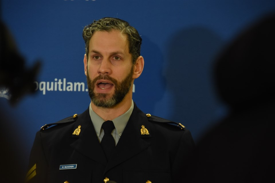 Coquitlam RCMP spokesperson Cpl. Michael McLaughlin speaks at a press conference following the annou