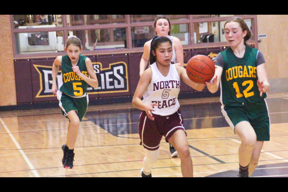 NPSS guard Sophia de Torres (#5) leads a fast-break against Dr. Kearney in the Peace Junior Regional Basketball Final in Fort St. John on February 8, 2020. NPSS won 74-32.