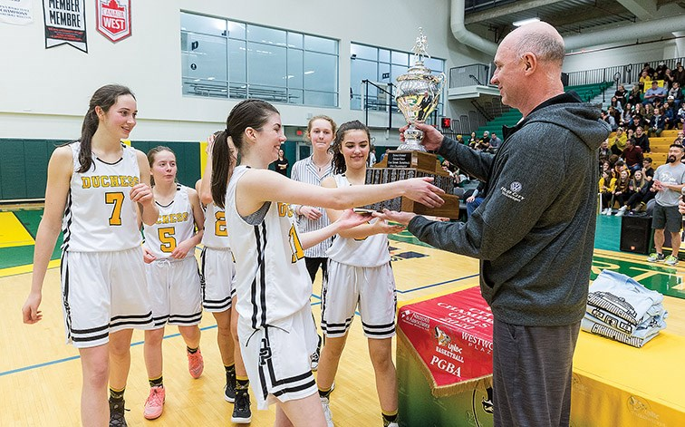 Citizen Photo by James Doyle. The Duchess Park Condors captains receive their trophy and banner after claiming their seventh consecutive Prince George Senior Girls High School Basketball City Championship after defeating the PGSS Polars by a score of 87-34.