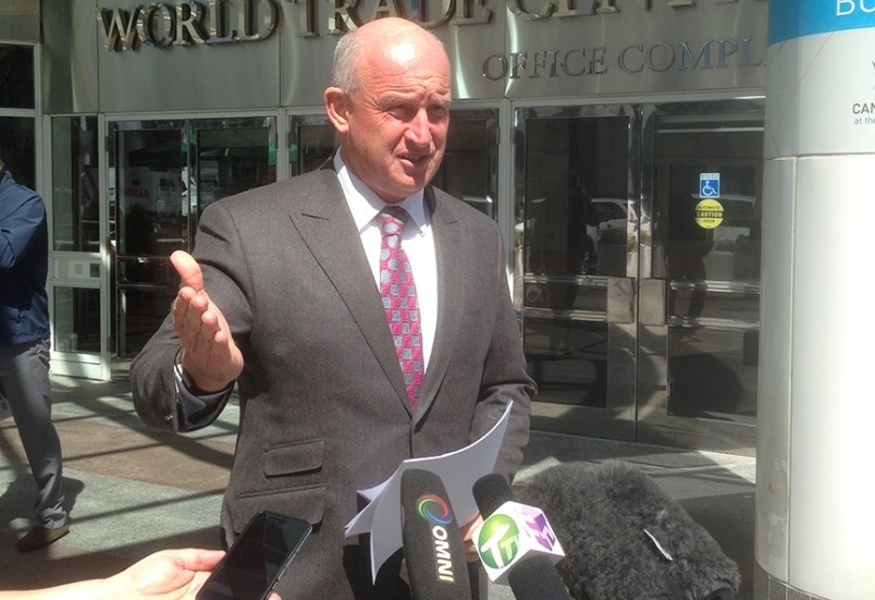 Mike Farnworth speaks to media at an unrelated event
