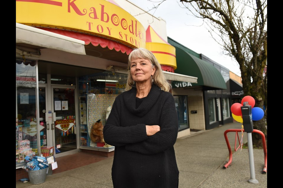 Kaboodles Toy Store owner Lee Richmond outside her business on West 10th Avenue, which is in the process of closing due to escalating rents and property taxes.