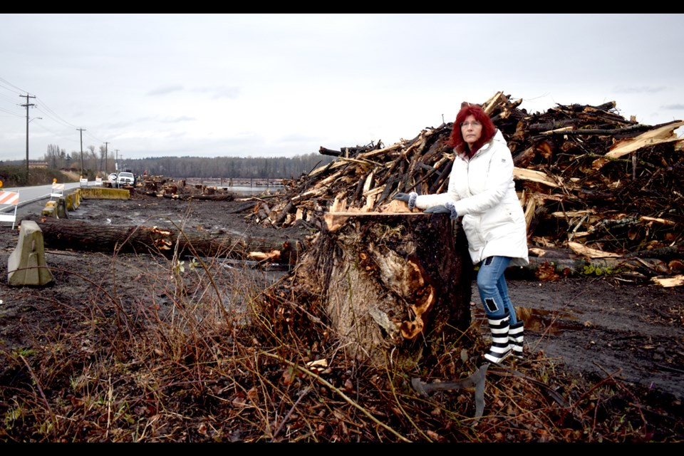 Arline Trividic was upset that trees along River Road in east Richmond were chopped down in anticipation of dike work.