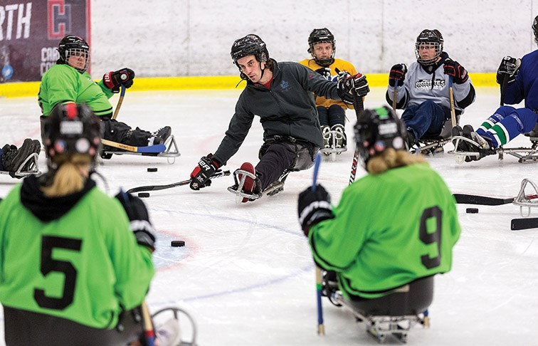 Citizen Photo by James Doyle. B.C. Hockey Para Ice Hockey Coordinator James Gemmell, centre, leads a stick handling drill on Saturday at Kin 1 during SportAbility BC's Para Ice Hockey Development Camp.