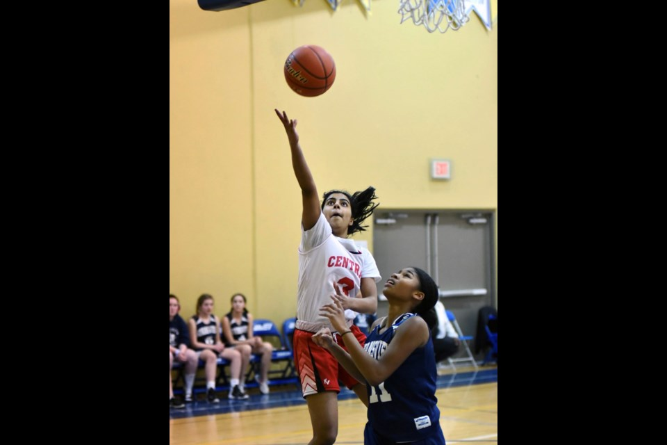 Tournament MVP Ankita Chopra puts up another two points for her Burnaby Central Wildcats at the B.C. Grade 8 girls championship finals last week in Abbotsford.