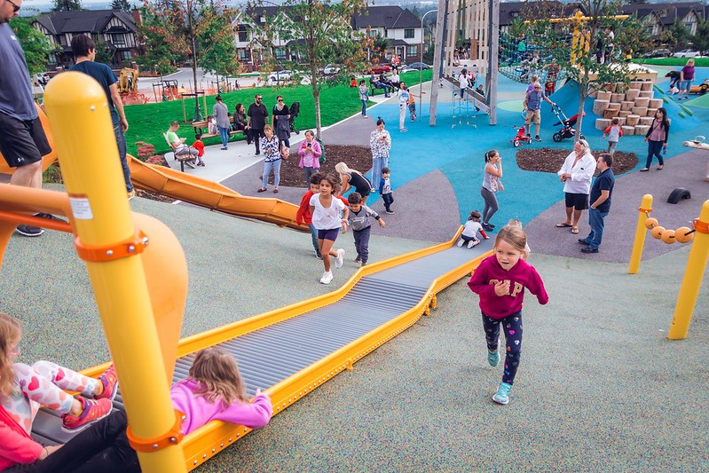 Children play at the opening of Smiling Creek Park on Burke Mountain in September 2019.