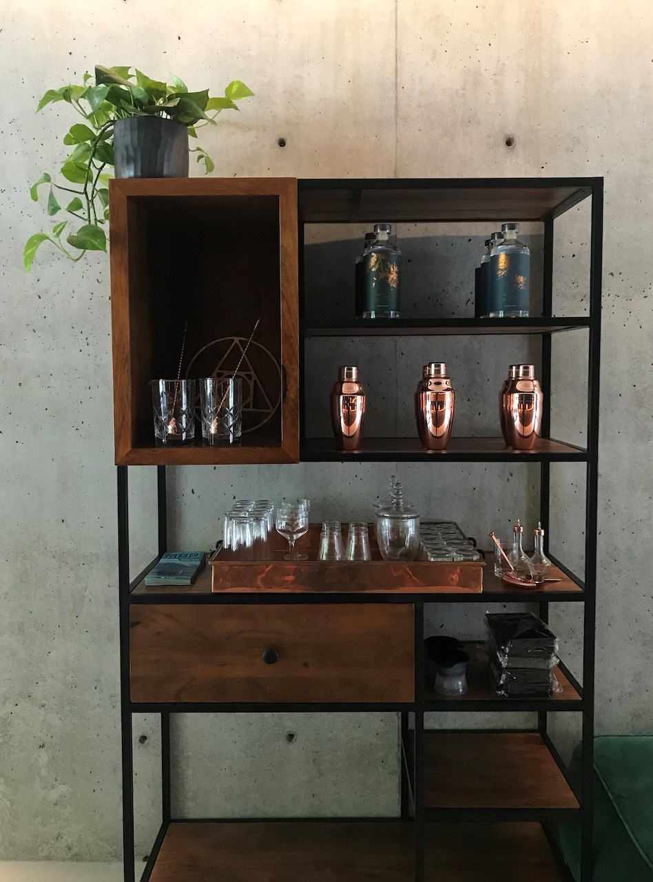 A shelf full of liquor products and accessories