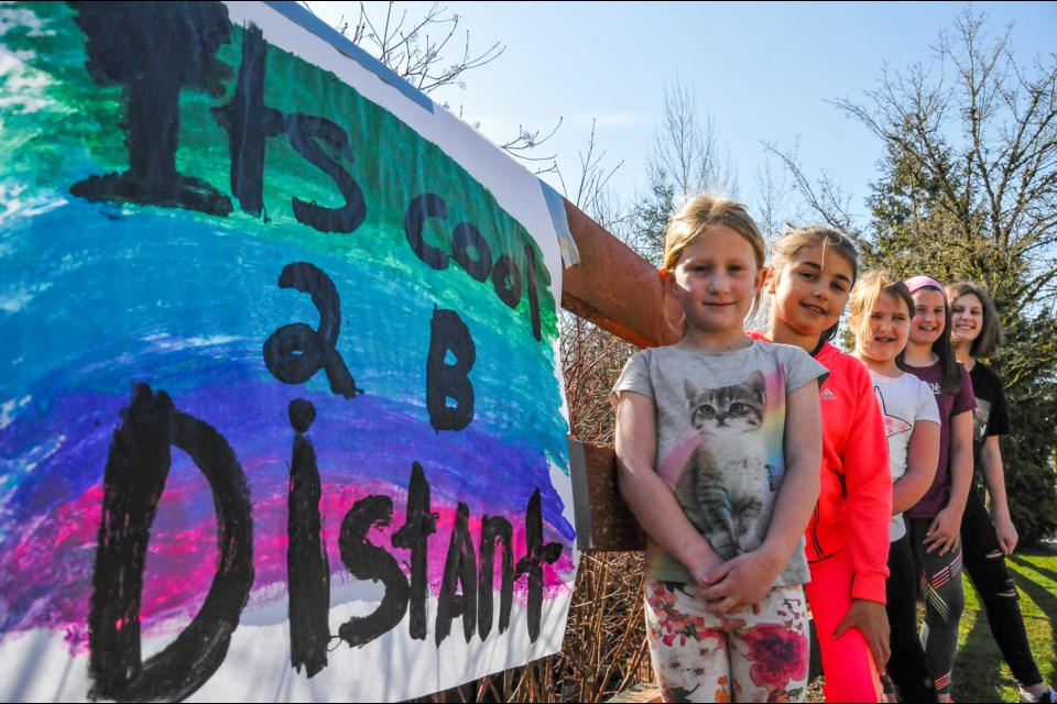 Seven children from Port Moody painted uplifting messages along their street to bring the community together from a distance.