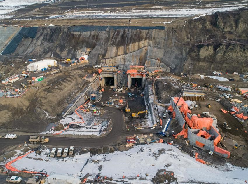 Aerial view of the diversion tunnel outlet portals and the temporary fish passage facility under construction at Site C, February 2020.