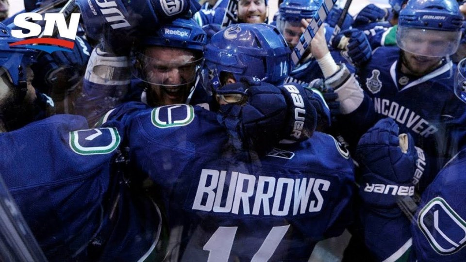 Alex Burrows celebrates his overtime game-winning goal over the Chicago Blackhawks with his Vancouve