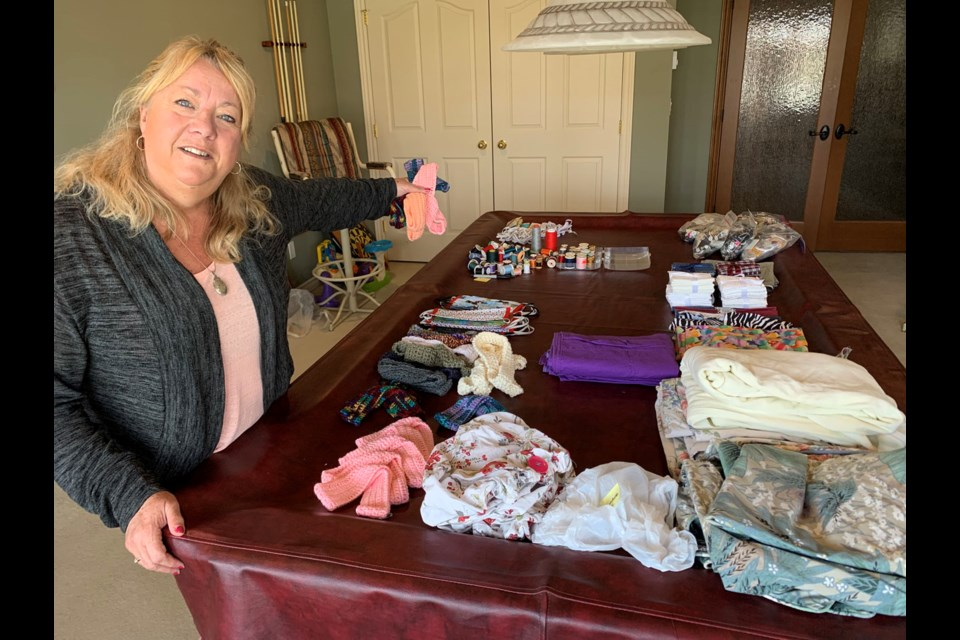 Ann Westlake has helped coordinate a community-wide effort to knit and craft items for health care workers here in South Delta.