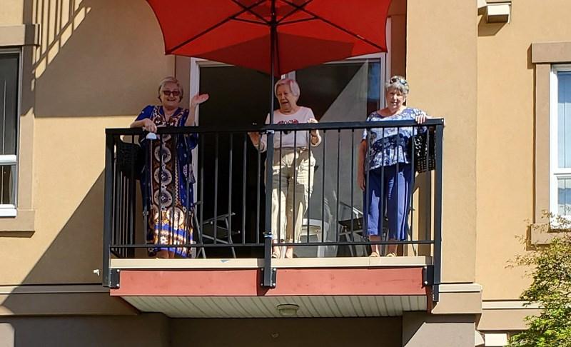 Thankful seniors express gratitude outside the Astoria Retirement Residence in Port Coquitlam.