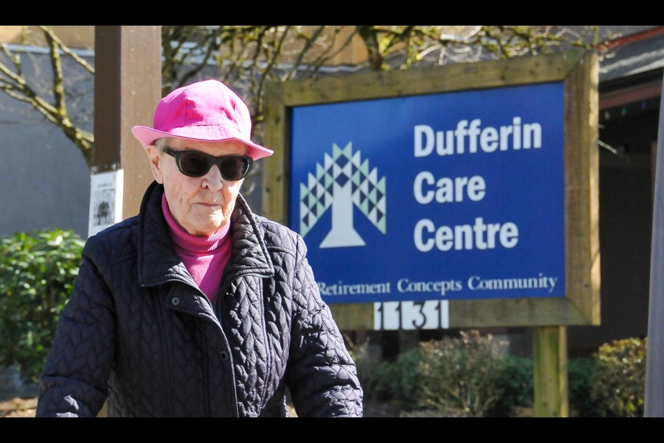A resident of a nearby seniors home passes in front of the Dufferin Care Centre the day the facility announced its first case of COVID-19.
