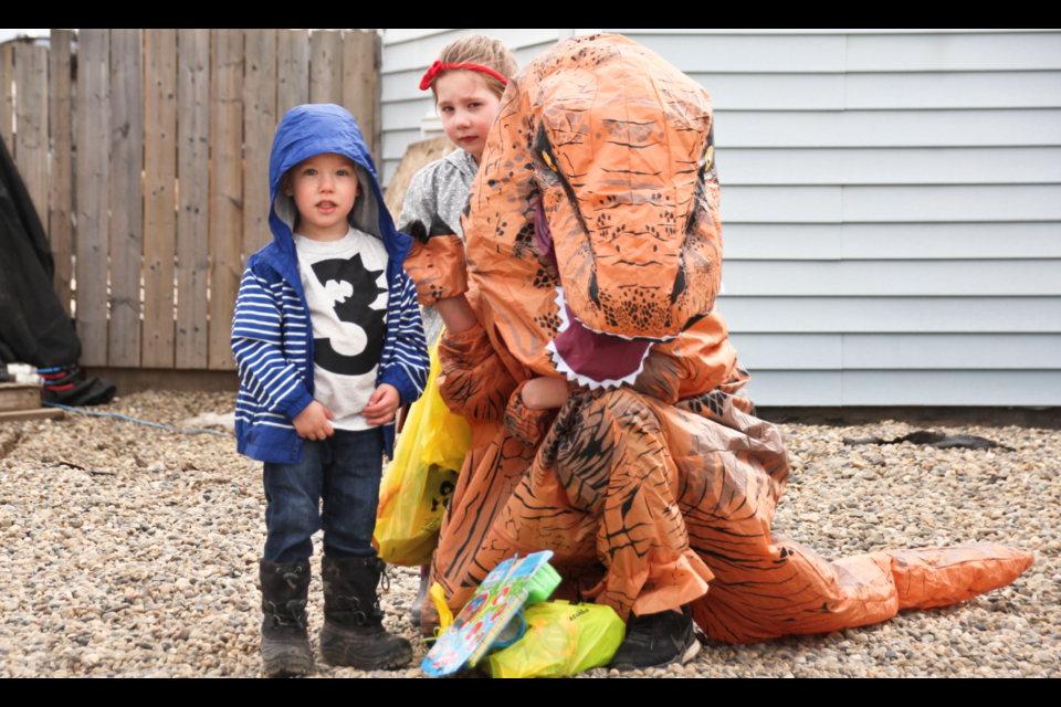 Parker Miller, sister Arleigh, and mom Michelle O'Laney (in dinosaur costume) during Parker's birthday parade on April 17, 2020.