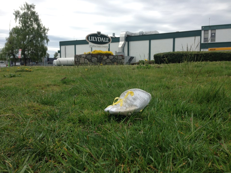 A medical mask discarded outside the Lilydale poultry processing plant run by Sofina Foods Inc. One