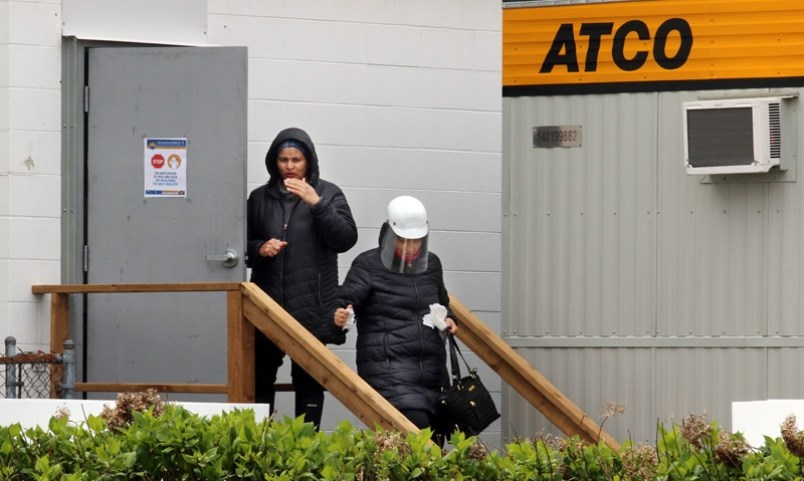 Workers leave Lilydale chicken processing plant in Port Coquitlam for their lunch break on Wednesday. Photograph By MARIO BARTEL/THE TRI-CITY NEWS