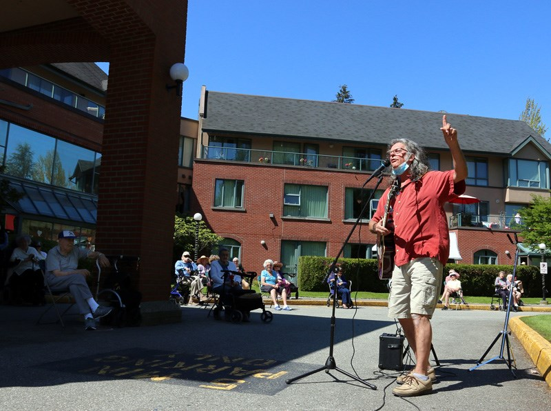 Chris Ridout teaches yoga and conducts a sing-a-long at Parkwood Manor in Coquitlam last Thursday.