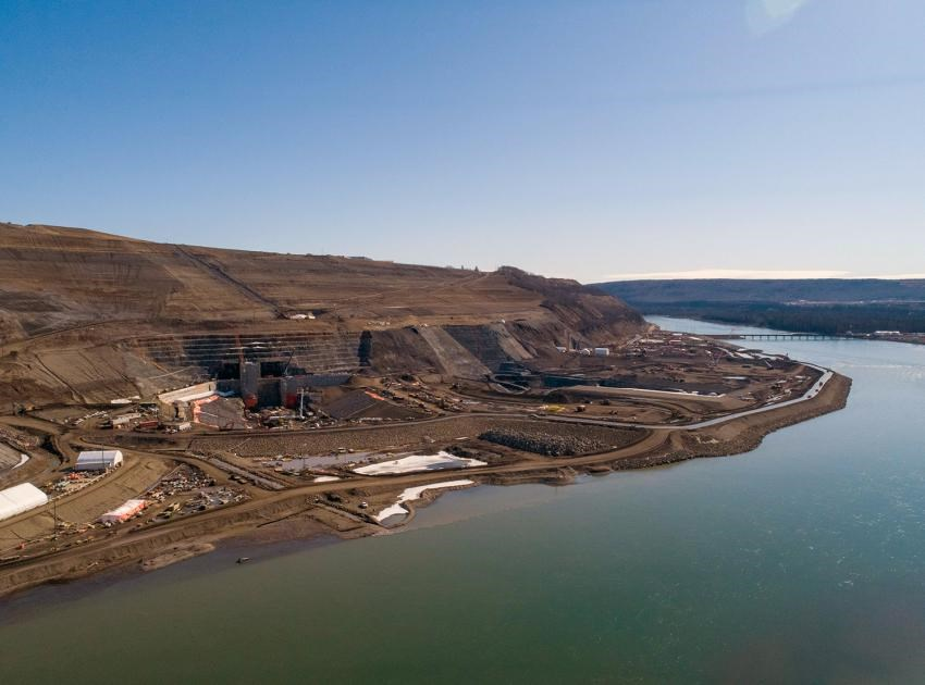 Aerial view of the upstream diversion tunnel inlet portals on the north bank of the Peace River at Site C, April 2020.