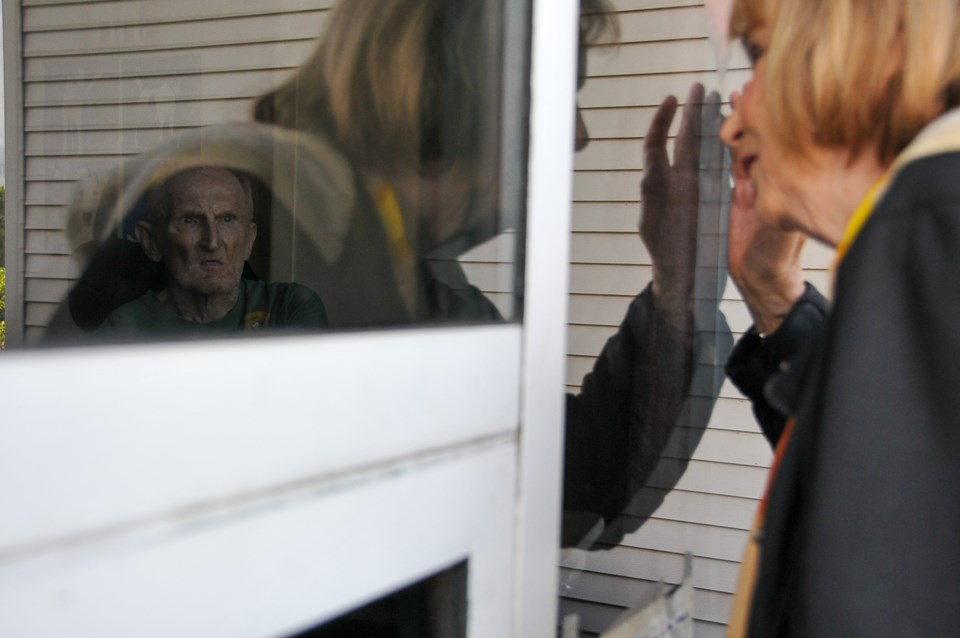 Brigitte and Bernie celebrated their 61st anniversary through the sealed window due to a public heal