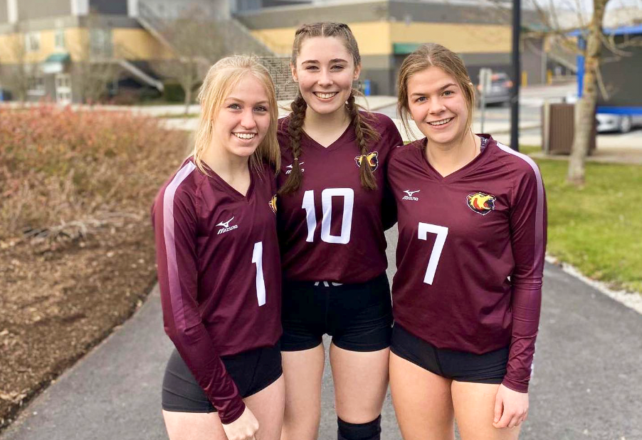 Breanna Hicks, centre, shares a moment with her NPSS Grizzlies volleyball teammates before a tournament earlier in the 2019-20 season.