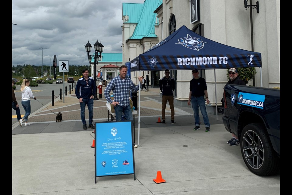 The Richmond FC team gets set up for the food bank drive at McArthurGlen on the weekend. Photo submitted