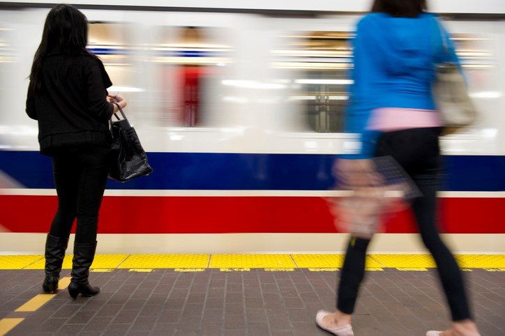 Commuters head to work on the SkyTrain
