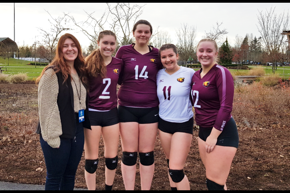Brynn Shaw (#2) and Megan Salinas (#11) with their NPSS volleyball teammates during the 2019-20 season.