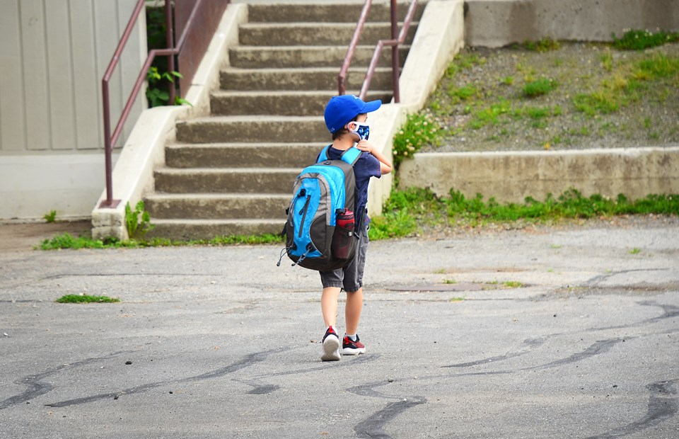 A Sperling Elementary School student heads back to school on June 1, three-and-a-half months after in-class instruction was suspended because of COVID-19.
