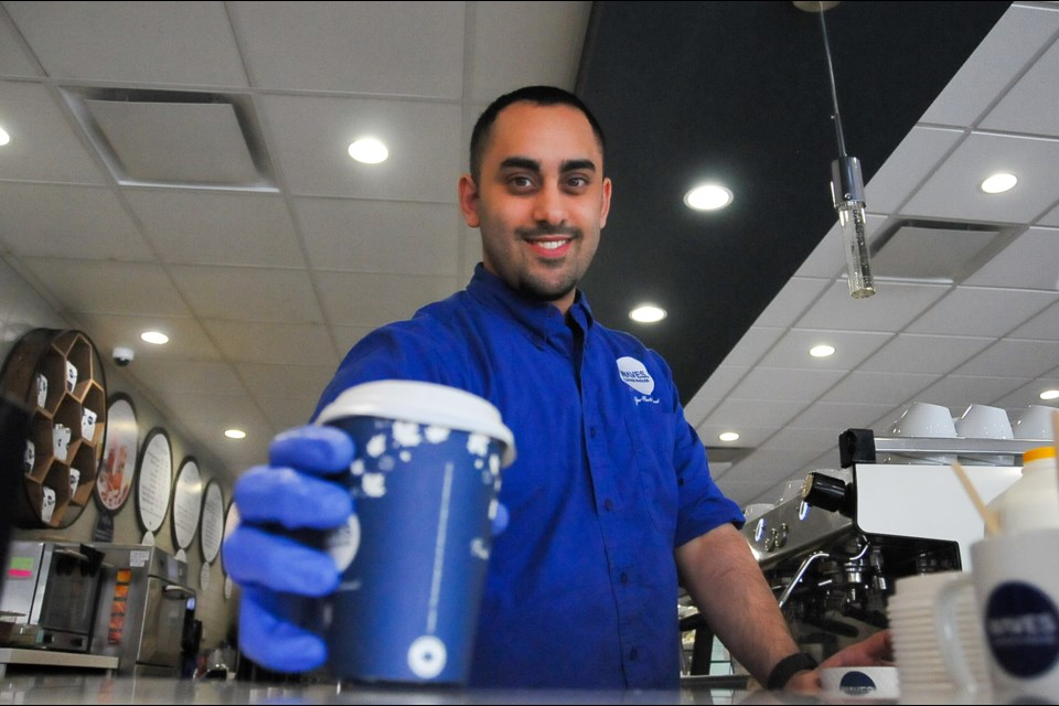 Kareem Adli, 23, works as a barista at the Waves Coffee House off Westwood Street and Lougheed Highway, putting his architecture career on hold to help out the family business.